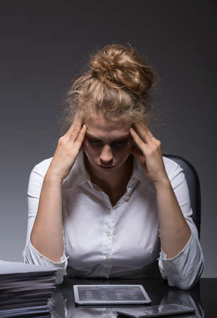 psychical: Young woman is very exhausted at the work Stock Photo