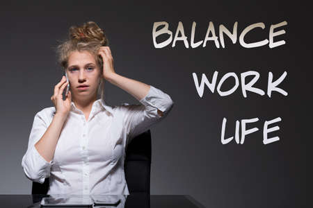 workaholic: Young woman is a workaholic with serious problems Stock Photo