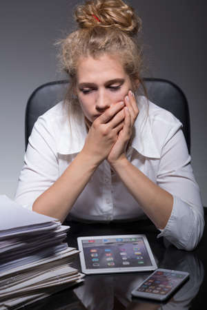 psychical: Young woman is very worried about her job