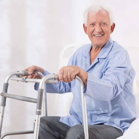 hospital patient: Hospital patient with a walking frame Stock Photo