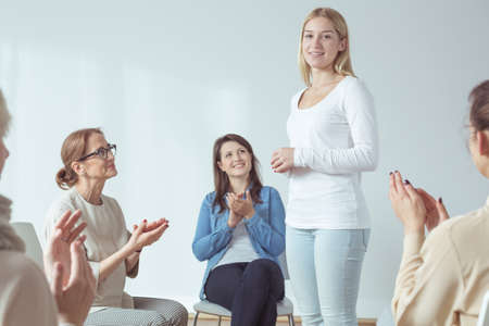 introducing: Young woman is introducing herself during meeting