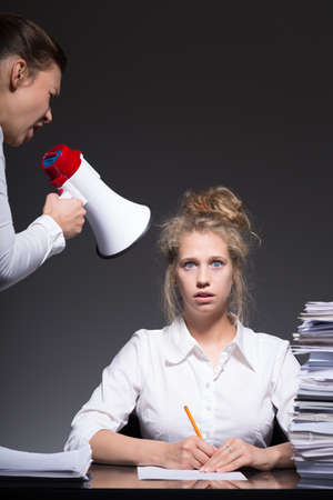 strict: Young woman has very strict boss at the work Stock Photo