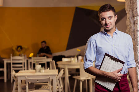 gastronomy: Young waiter and work in small gastronomy