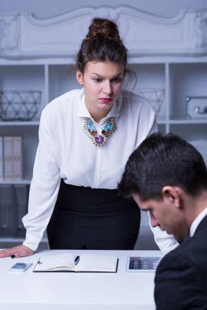 the boss: Attractive woman boss reprimanding her employee