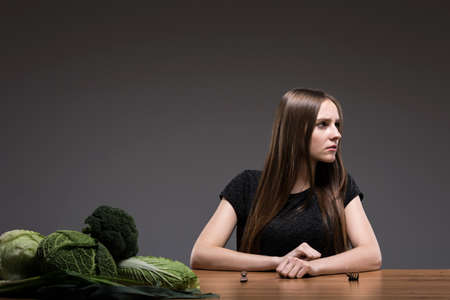 disgusted: Disgusted girl with anorexia waiting for dinner