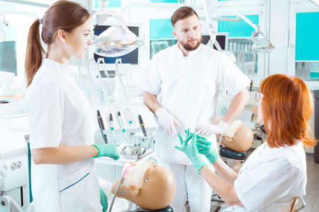 well equipped: Teacher and students of dentistry in well equipped classroom Stock Photo