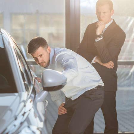 sell car: Car showroom customer