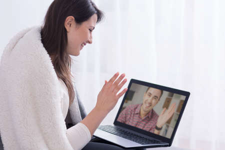 Woman talking with man via internet
