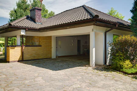 External view of beautiful stylish mansion with garage and backyard Stock fotó