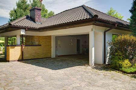 External view of beautiful stylish mansion with garage and backyard Фото со стока