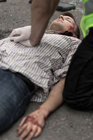accident rate: Policeman doing chest compression to injured man Stock Photo
