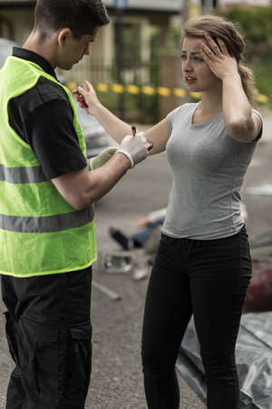 Young woman is telling policeman about car accident