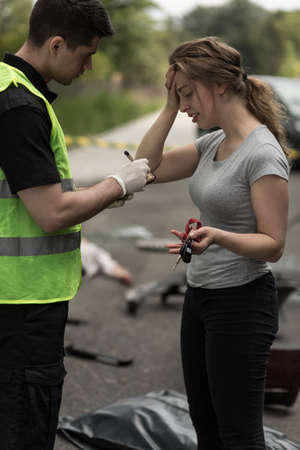 describe: Woman which caused accident is telling police about incident Stock Photo