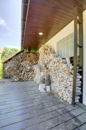 woodshed: Image of domicile woodshed beside new luxurious house