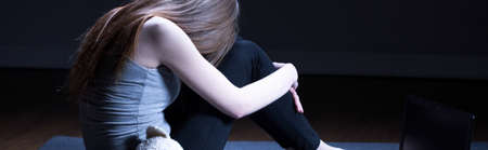 maltreatment: Young teen girl is feeling depressed and sad