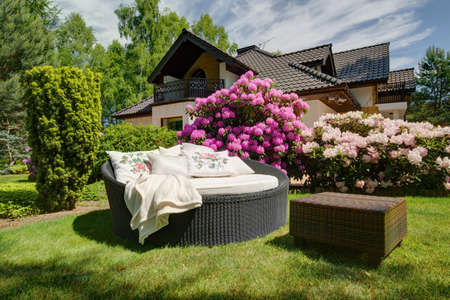Picture of simple rattan garden sofa and small table
