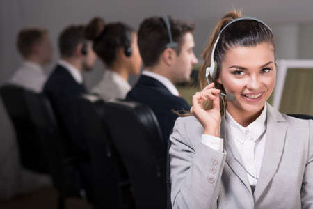 teleoperator: Beautiful sales woman with headset during work, smiling