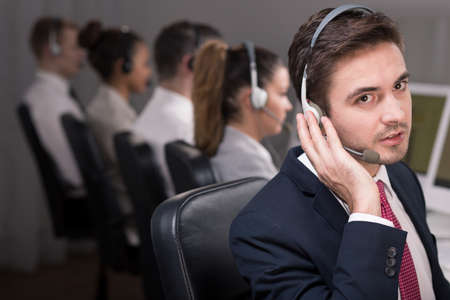 telephone salesman: Man with headset working in call center
