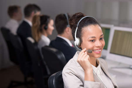 teleoperator: Woman with headset working in call center Stock Photo
