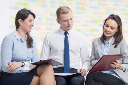 togther: Positive businesspeople working togther, sitting in light office