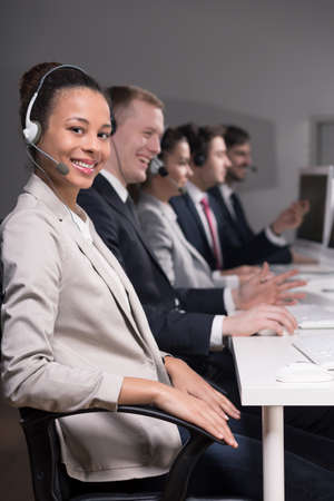 teleoperator: Telemarketers during work in professional call center