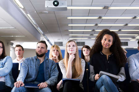lecture hall: Group of students sitting in lecture hall Stock Photo
