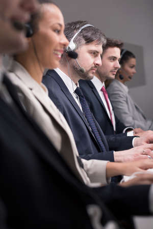 teleoperator: Professional workers of call center during work Stock Photo