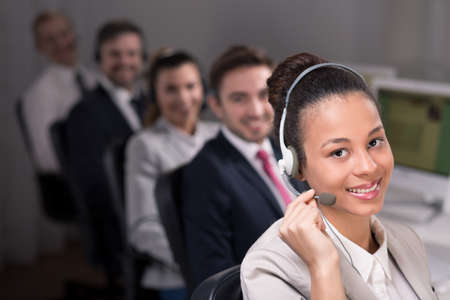 teleoperator: Telemarketer woman with headphones and microphone, smiling