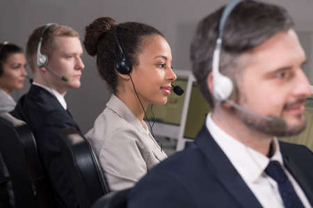 teleoperator: Group of call center workers with professional headsets