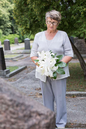 tribute: Elder lady is holding a floral tribute