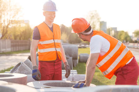 speaking tube: Picture of smiling labourers on road construction Stock Photo