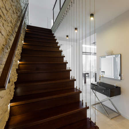 stairs: Stylish wooden stairs in modern elegant hallway