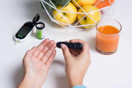 blood glucose level: Close up of diabetic doing blood glucose  level test