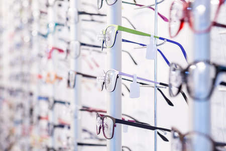Row with colorful modern eyeglasses on exhibition
