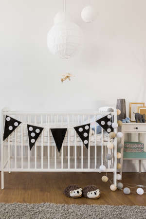 room decorations: Little bed for baby in new stylish room Stock Photo