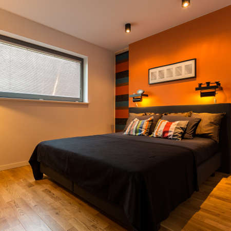 bedroom wall: Elegant bedroom with cosy lights and orange wall