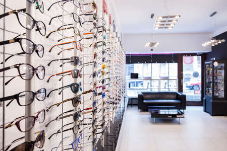 Opticians shop shelves with eyeglasses rims Stock Photo