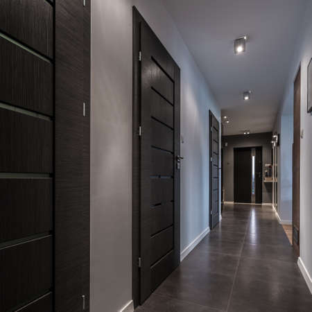 luxury house: Long and gray corridor in luxury house