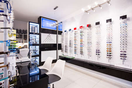 Selection of modern eyeglasses rims at opticians store
