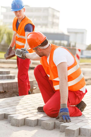 road worker: Picture of busy road worker making new pavement Stock Photo