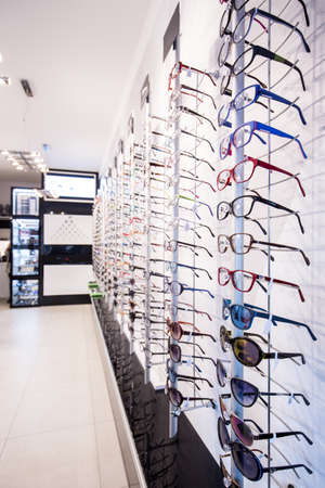 optical: Exhibition of colorful eyeglasses rims at opticians store Stock Photo