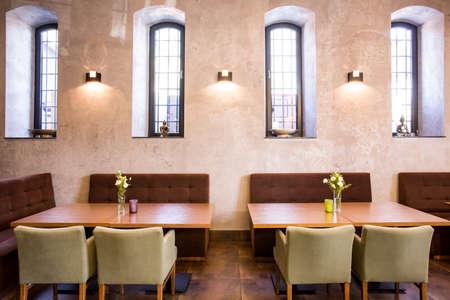 Simple modern diner with wooden tables Reklamní fotografie