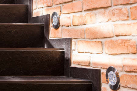 red brick wall: Stone brown stairs and wall of red brick