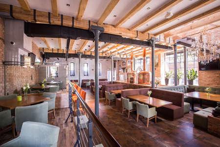 Interior of spacious modern restaurant with wooden floor