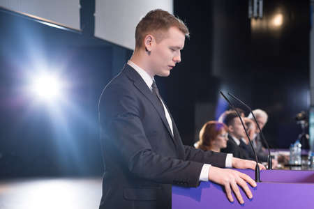 politician: Young politician giving speech during his election campaign