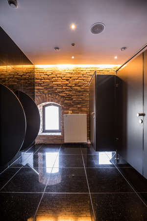 bathroom tiles: Fancy public bathroom with black shining tiles Stock Photo