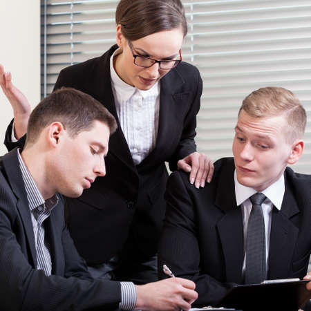 gesticulating: Gesticulating woman and their co-workers in suit