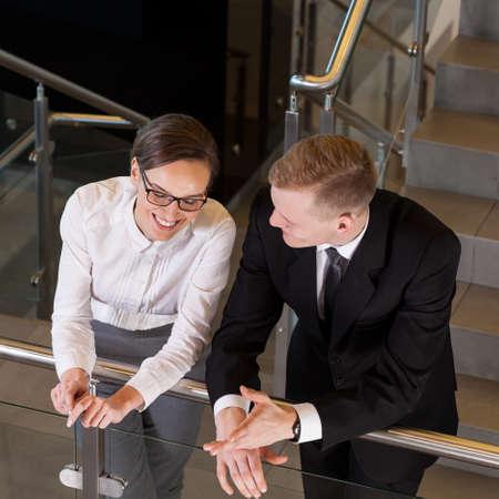 break from work: Business people talking during break from work, horizontal Stock Photo