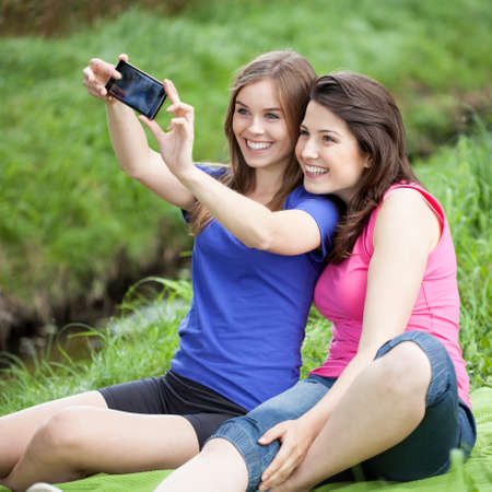 glade: Girls taking a selfie on a glade Stock Photo