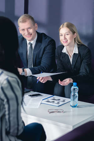 bisiness: Man and woman in elegant suits during bisiness meeting with client Stock Photo